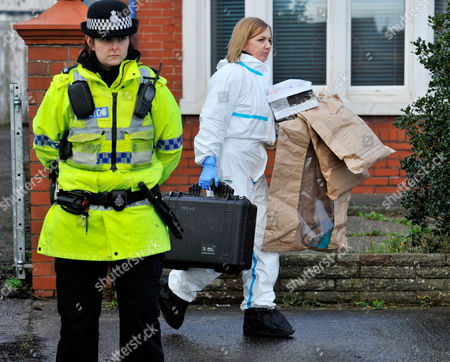 Forensic Staff Leave With Evidence Bags As They Continue Their Work At The Scene Of A House Fire In Freckleton Lancs Which Killed Four Year Old Twins Holly Smith And Ella Smith Jordan Smith 2 And Brother Reece Smith 19.  9.1.12.