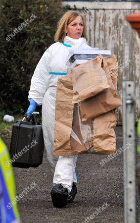 Forensic Staff Leave With Eveidence Bags As They Continue Their Work At The Scene Of A House Fire In Freckleton Lancs Which Killed Four Year Old Twins Holly Smith And Ella Smith Jordan Smith 2 And Brother Reece Smith 19.  9.1.12.