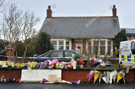 Floral Tributes Left Outside The House Fire In Freckleton Lancs Which Killed Four Year Old Twins Holly Smith And Ella Smith Jordan Smith 2 And Brother Reece Smith 19.  9.1.12.