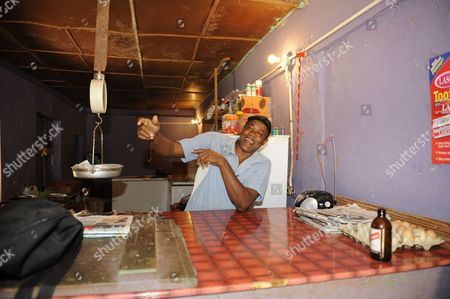 Usain Bolt's Father Gideon Known As Wellesley Bolt At His Butchers Shop Kingston Jamaica.