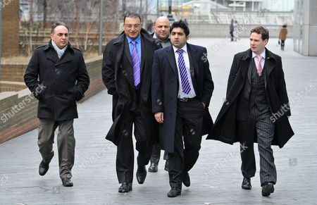 Editorial photo of Scotland Yard Commander Ali Dizaei Leaving Southwark Crown Court With His Entourage This Afternoon. Stephanie Schaerer 00447878466804.