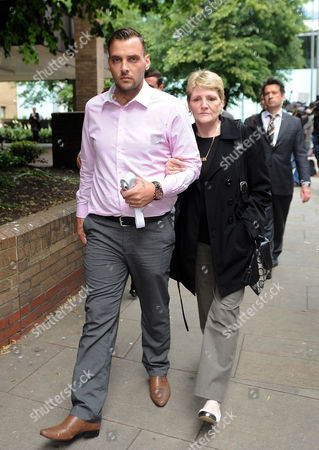 London. Julia Tomlinson The Widow Of Iantomlinson Leaves Southwark Crown Court With Her Son Paul King And Other Family Members After The First Day Of The Trial Of Pc Simon Harwood Who Is Accused Of Manslaughter Of Her Husband Ian Tomlinson