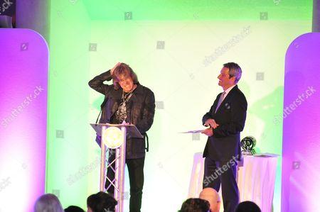 London United Kingdom - September 4: British Rock Musician Keith Emerson Presenting The Virtuoso Award To His Elp Bandmate Carl Palmer At The 2012 Progressive Music Awards In Kew Gardens London On September 4