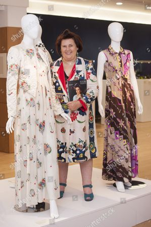 Suzy Menkes with a cream silk crepe full length Ossie Clark dress printed with a Celia Birtwell floral design