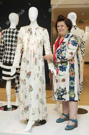 Suzy Menkes with a cream silk crepe full length Ossie Clark dress printed with a Celia Birtwell floral design.