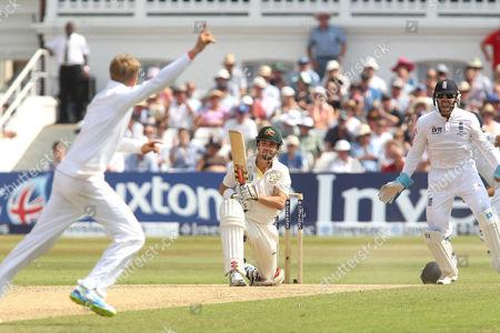 England's Joe Root (L) celebrates the wicket of Australia's Ed Cowan (centre) caught Trott out for 14 runs - England v Australia - 1st Investec Test Match - Ashes Series 2013 - Day 4 - Trent Bridge - Nottingham - 13/07/2013