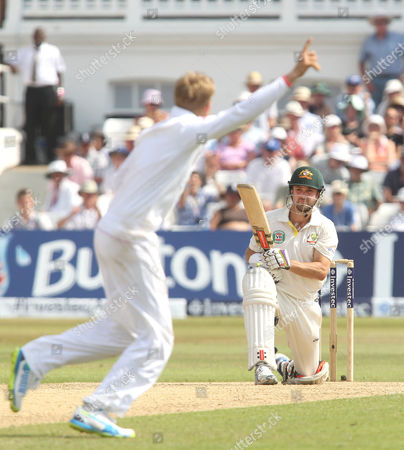 England's Joe Root (L) celebrates the wicket of Australia's Ed Cowan (R) caught Trott out for 14 runs - England v Australia - 1st Investec Test Match - Ashes Series 2013 - Day 4 - Trent Bridge - Nottingham - 13/07/2013