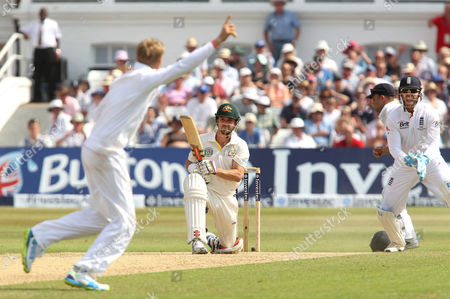 Stock Image of England's Joe Root (L) celebrates the wicket of Australia's Ed Cowan (centre) caught Trott out for 14 runs England v Australia - 1st Investec Test Match - Ashes Series 2013 - Day 4 - Trent Bridge - Nottingham - 13/07/2013