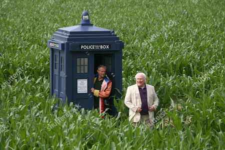 Farmer Tom Pearcy and Colin Baker the Sixth Doctor (1984-1986) with the Tardis in amongst the 18 acres of maize