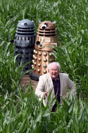 Stock Picture of Colin Baker the Sixth Doctor (1984-1986) with the Daleks in amongst the 18 acres of maize