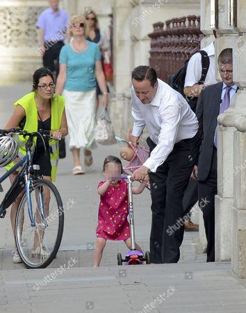 Prime Minister David Cameron walking his daughter Florence to nursery