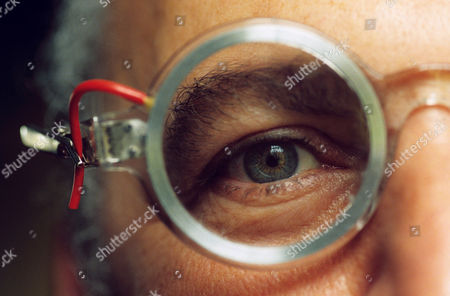 Self correcting spectacles which contain water between lenses