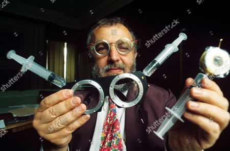 Dr Joshua Silver with his self correcting spectacles which contain water between lenses