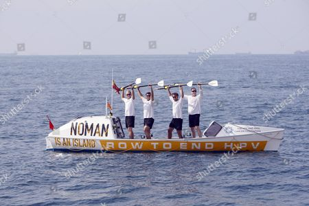 Former Olympic Champion Mark Hunter leads a team of City workers to victory in an endurance Rowing challenge whilst raising money to combat  HPV related cancers, rowing from Barcelona to Ibiza in just 70 hours. www.nomanisanisland.co.uk
