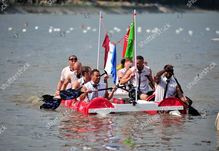 Nev Wilshire with his team competing in the annual Mumbles Raft Race in Swansea Bay