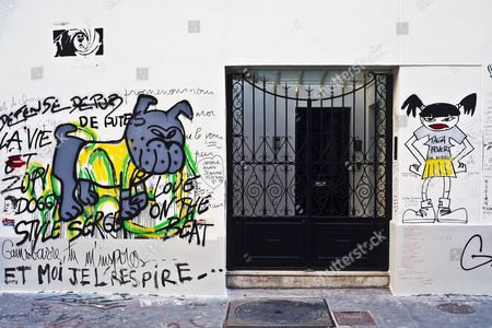 The facade of the house of Serge Gainsbourg on the rue de Verneuil has been freshly painted white so fans may adorn it with new artworks