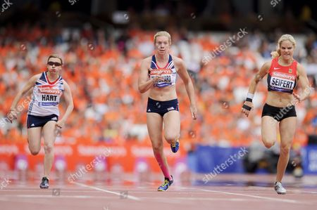 Bethany Woodward runs against Maria Seifert of Germany (right) and Katrina Hart of Great Britain in the 100m Women T37 Final