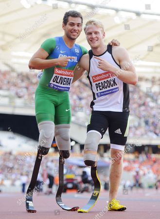 Stock Picture of Alan Oliveira of Brazil and Jonnie Peacock of Great Britain after the 100m Men T43/44 Final