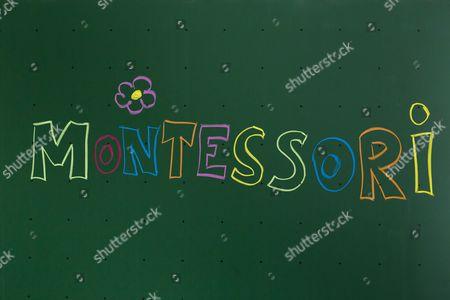 Stock Photo of ''Montessori'' written with chalk on a blackboard