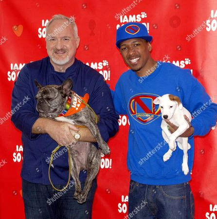 Art Smith and his dog Cochon and Nick Cannon with his dog The Reverend Paw Jackson