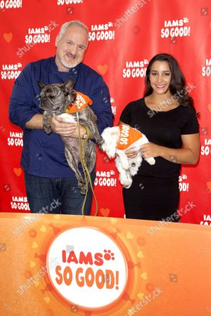 Art Smith and his dog Cochon and Alexandra Raisman with her dog Coco