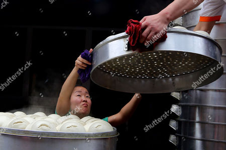 Editorial image of Man can steam 40 layers of steamed buns in one go, Kunming, Yunnan Province, China - 15 Jul 2013