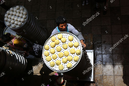 Editorial photo of Man can steam 40 layers of steamed buns in one go, Kunming, Yunnan Province, China - 15 Jul 2013