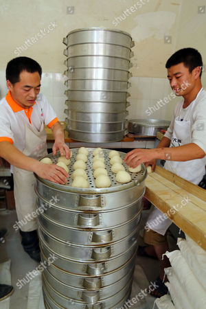 Editorial picture of Man can steam 40 layers of steamed buns in one go, Kunming, Yunnan Province, China - 15 Jul 2013
