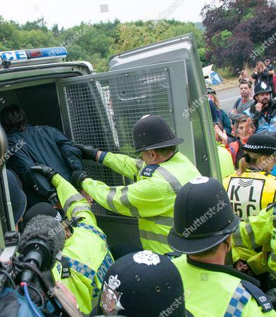 Natalie Rae Hynde being arrested after supergluing herself to partner Simon Medhurst at the gates of the fracking site