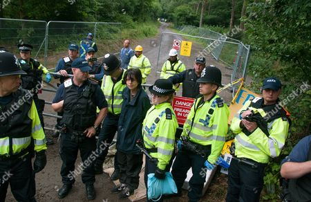 Stock Picture of Natalie Rae Hynde being arrested after supergluing herself to partner Simon Medhurst at the gates of the fracking site