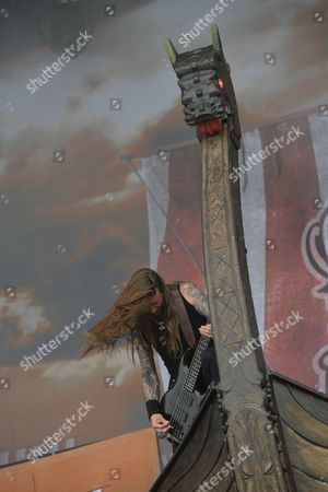 Castle Donington, Britain. Bassist Ted Lundstrom Of Swedish Death Metal Group Amon Amarth Performing Live On The Zippo Encore Stage At Download Festival