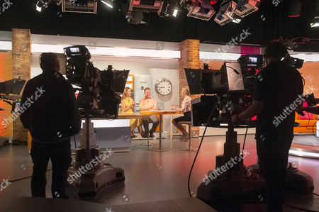 Carla Buzasi and Michael Portillo with Helen Fospero, studio, set, camera