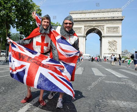 British Fans And Supporters Line The Champs- Elysees In Paris This Morning To Watch Bradley Wiggins As He Becomes The First British Winner Of The Tour De France. Tim And Tom Ward Supported Team Sky All Along The Way The Tour De France This Year.