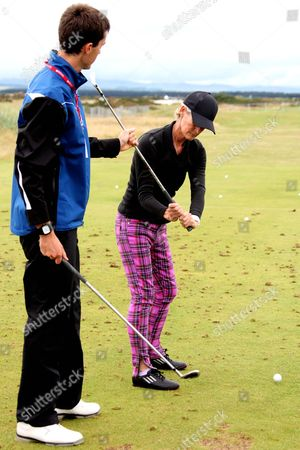 Editorial image of Judy Murray taking golfing lessons at Ricoh Women's Open Golf Championship, St Andrews, Scotland, Britain  - 01 Aug 2013