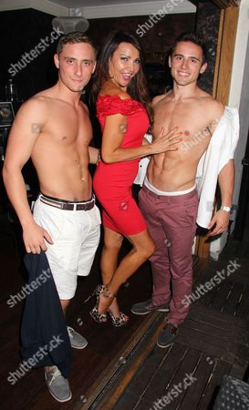 Stock Photo of Lizzie Cundy with her dancers, Matt and Rory Phelan