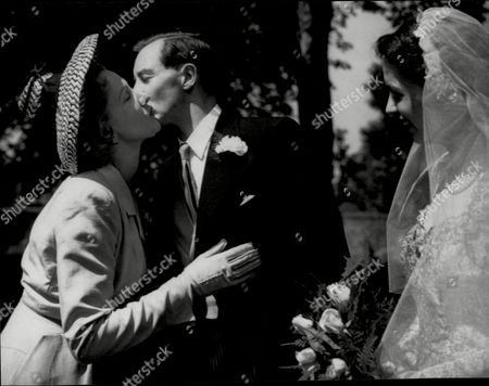 Actress Anne Crawford Kissing Her Brother Thomas After His Wedding To Martha Maclean In Edinburgh.
