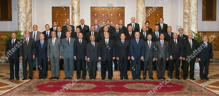 Interim president Adly Mansour posing for a picture following the first meeting of the 20 newly appointed Egyptian Governors in Cairo