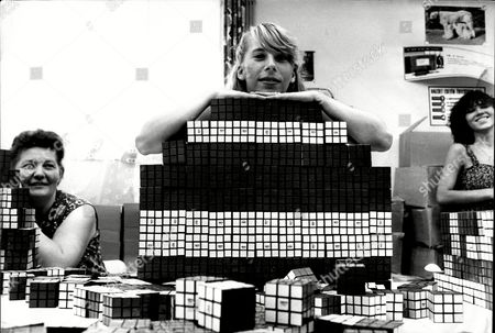 Stock Picture of Eva Toth Aged 20 With A Mountain Of Rubik's Cubes.