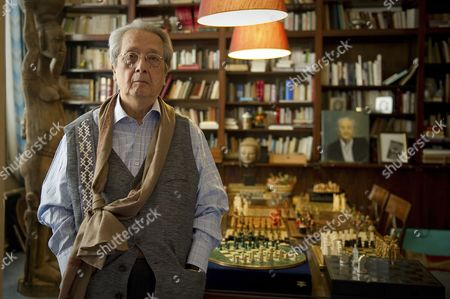 French lawyer Jacques Verges poses in his office