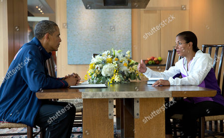 National Security Advisor Susan E. Rice briefs United States President Barack Obama