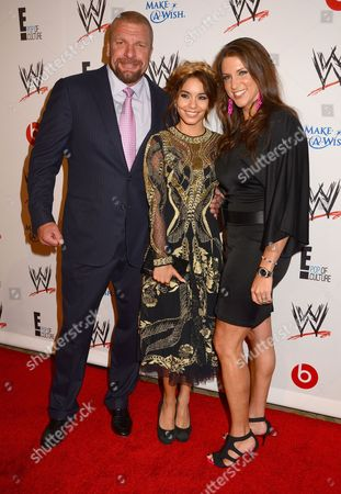Stock Picture of Paul Levesques, Vanessa Hudgens, Stephanie McMahon-Levesque