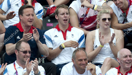 Editorial photo of Olympics London 2012. Womens Marathon 10 Km Swim. From Left: David Cameron David Carry Gb Swimmer Also Keri-anne-payne's Boyfriend And Rebecca Adlington.