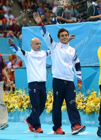 Editorial Use Only This Material Is Provided Under The Terms Of The 2012 Nopp Agreement. Mandatory Credit Must Be Observed London 2012 Olympic Games Aquatics Centre Men's 10m Platform Dive Great Britains Tom Daley (right) And Peter Waterfield Enter Area To Applause.