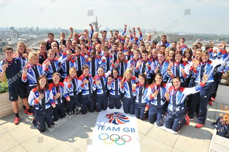 Editorial photo of London 2012 Olympic Games 73 Of Team Gb's Medalists Stand On The Roof Of Team Gb House To Celebrate On The Last Day Of The London 2012 Olympics Bottom Row (l-r) Helen Richardson (hockey) Sarah Thomas (hockey) Nicola White (hockey) Hannah Macleod (ho