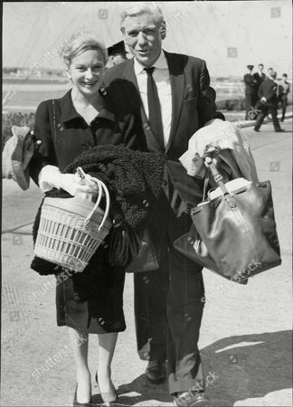 Actors Andre Morell And Joan Greenwood At London Airport.