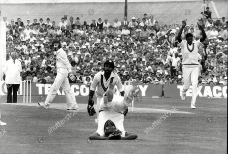 Cricket: West Indies Tour Of England 1984 - England V West Indies Test Match At Old Trafford - Graeme Fowler Is Caught In Slips By Clive Lloyd After Keeper Jeff Dujon Missed. Joel Garner (r).