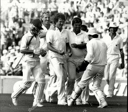 Editorial image of Cricket: Australian Tour Of England 1985 - England V Australia 1985 - Richard Ellison Is Congratulated By Team Mates Including Ian Botham And Mike Gatting After Dismissing Dirk Welham.