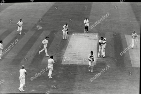 Stock Picture of Cricket: Australian Tour Of England 1985 - England V Australia 5th Test At The Oval - Allan Border Leaves After Being Caught Out. Bowler Richard Ellison Being Hugged By Paul Downton.