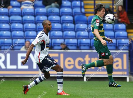 Joey Barton of QPR and David N'Gog of Bolton Wanderers