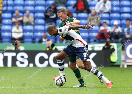 David N'Gog of Bolton Wanderers and Clint Hill of QPR